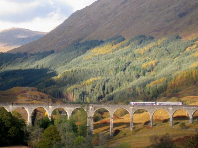 The Glenfinnan viaduct minus flying magical cars.
