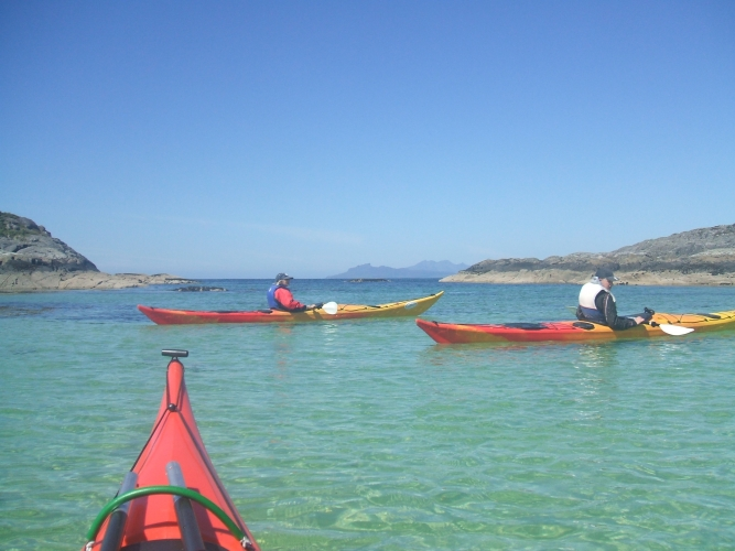 Sea-kayaking with views of Rhum in the distance.