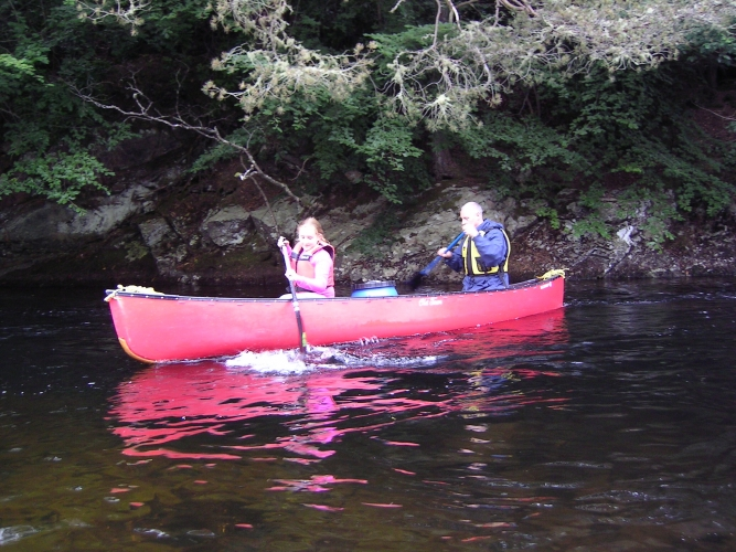 Canadian canoeing on the River Arkaig.